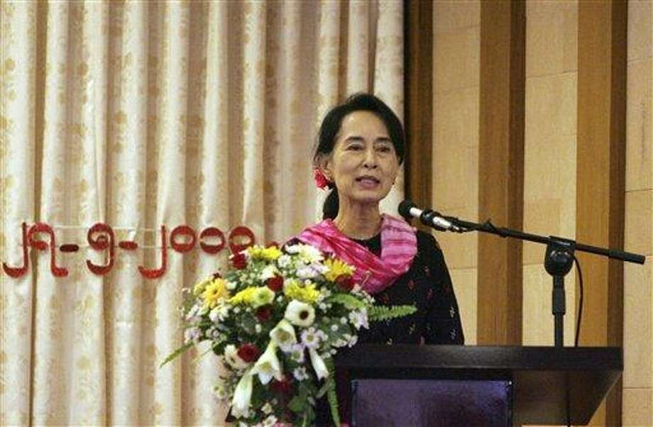 Myanmar Opposition Leader Aung San Suu Kyi speaks during Central Executive Committee (CEC) meeting of her National League for Democracy party at a restaurant in Yangon, Myanmar, Monday, May 27, 2013. Suu Kyi, rights groups and Islamic leaders have expressed dismay over plans by authorities in western Myanmar to revive a two-child limit on Muslim Rohingya families. (AP Photo/Khin Maung Win) Photo: AP / AP