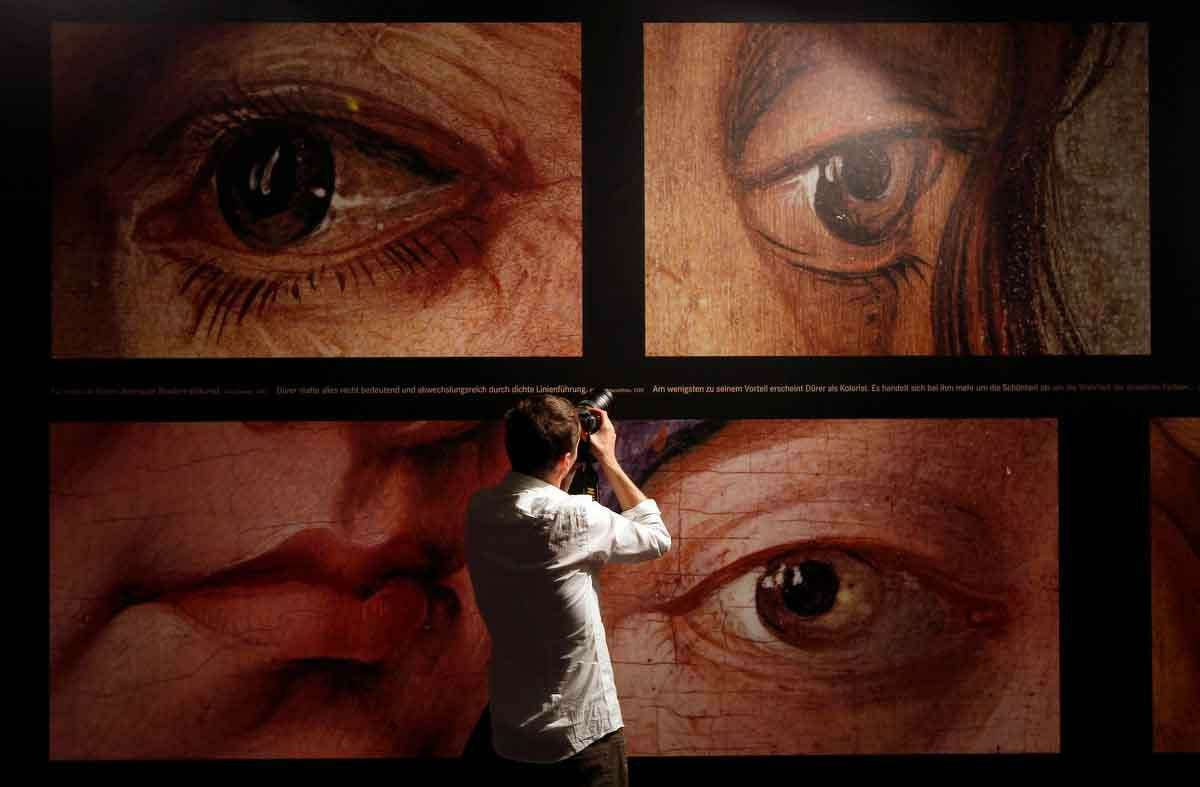 A man takes photos at the Albrecht Duerer exhibition during a press preview in the Germanisches Museum in Nuremberg, Germany, Tuesday, May 22, 2012. Germany's biggest exhibit of works by German artist Albrecht Duerer will open to the public from May 24 until September 2, 2012. (AP Photo/Matthias Schrader)