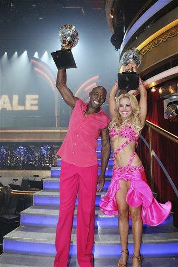 "In a photo provided by ABC, Donald Driver and Peta Murgatroyd hold up their trophies after they were crowned ""Dancing with the Stars"" champions Tuesday. They won the ABC dance show after wowing audiences and judges with their kickin' country-themed freestyle routine. Associated Press Photo: AP / © 2012 American Broadcasting Companies, Inc. All rights reserved."