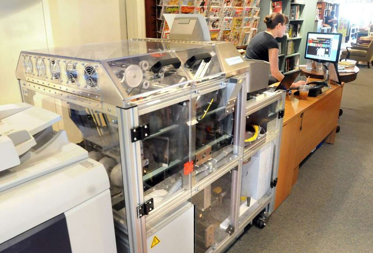The Espresso Book Machine is now set up at RJ Julia Bookselllers in Madison. The machine prints out a currently available book as you wait (not waiting for an order), books in public domain, or your own book or collection of printed matter. Bronwen Blaney of On Demand Books sets up a book on her computer. Mara Lavitt/New Haven Register