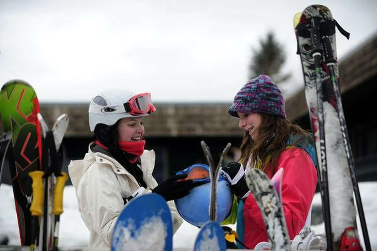 ASPEN, CO. - JANUARY 24: Kendall Tomkins, 18, left, and Jordan Lally, 15, of Virginia Beach, Virginia, joke about their goggles after skiing on Buttermilk Mountain at the 2013 Aspen X Games. They come to the area to ski and see the X Games every year. (Photo By Mahala Gaylord / The Denver Post)