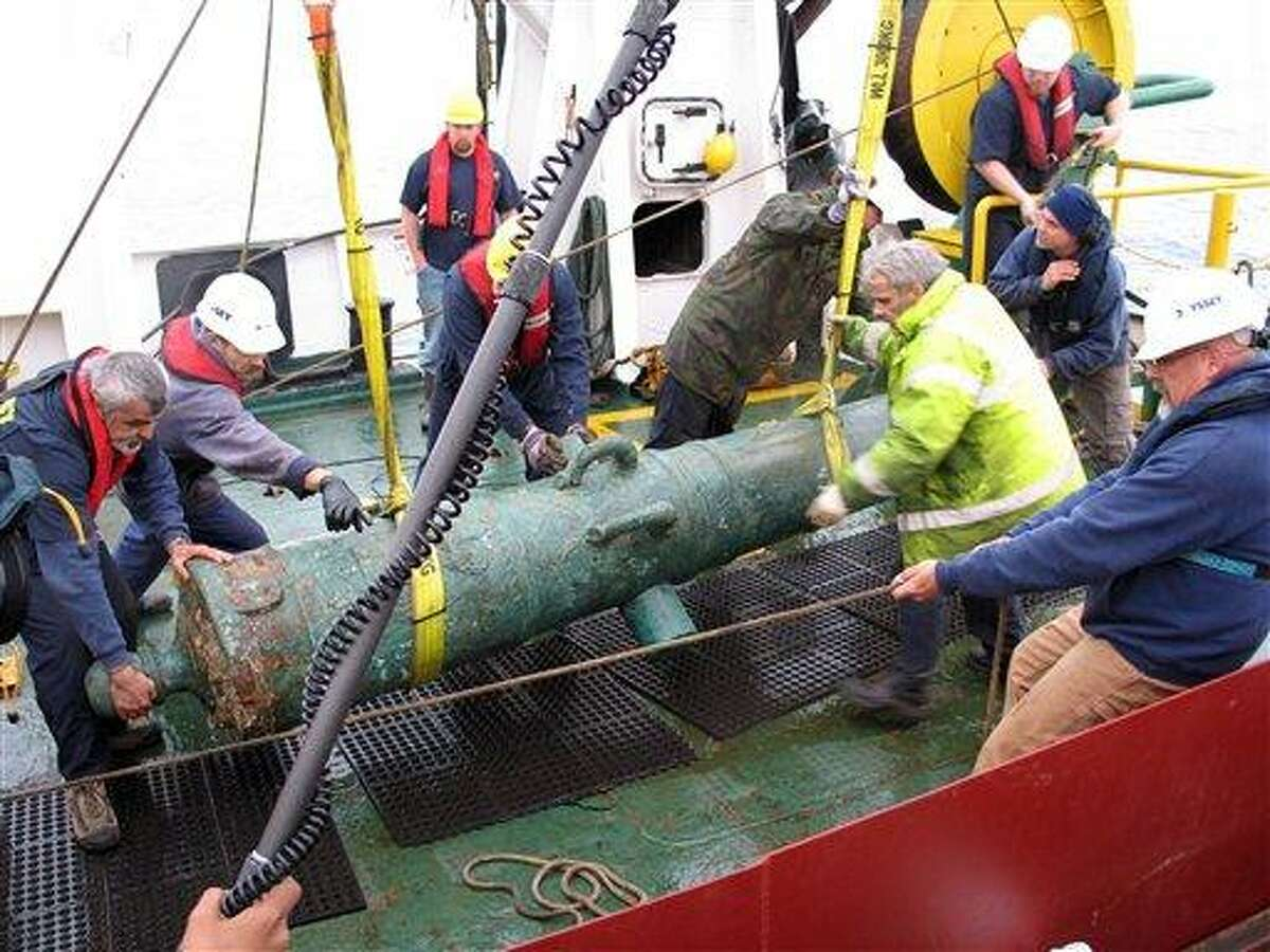 The 42-pounder bronze cannon recovered from the shipwreck site of HMS Victory in the English Channel in 2008 is lowered onto the deck of the Odyssey Explorer. A British maritime charity says that a Florida-based deep-sea salvage company will help explore the wreck of the renowned 18th-century warship it discovered at the bottom of the English Channel four years ago. The newly established Maritime Heritage Foundation said Monday that Odyssey Marine Exploration Inc. plans to scan the wreck of the HMS Victory with a robotic submersible with an eye toward answering questions such as why the ship sank beneath the waves and whether it carried any treasure. Associated Press