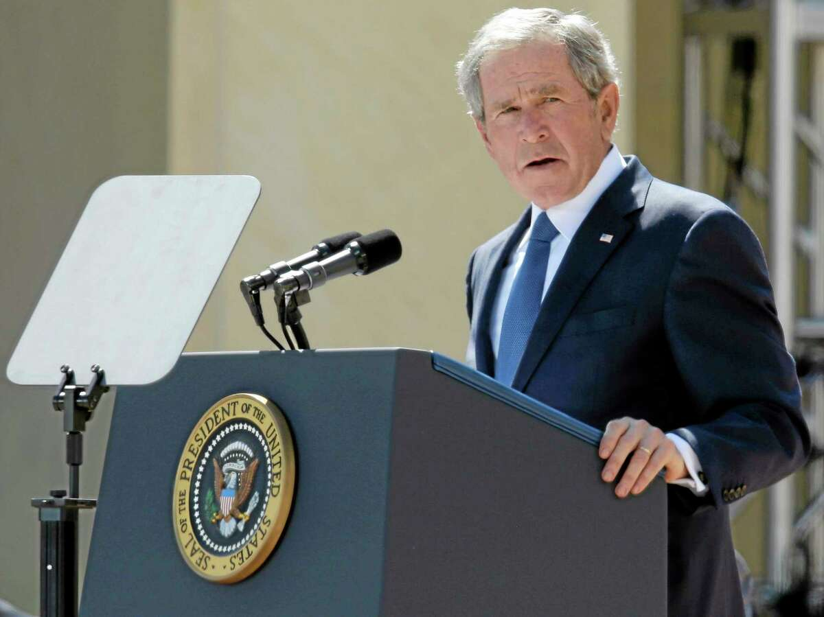 File - Ex-president George W. Bush in August discusses his heart surgery to clear a blocked artery. (AP Photo/Tony Gutiérrez, Pool)