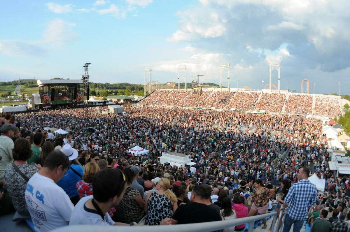 More than 30,000 people fill Hersheypark Stadium for the annual Farm Aid concert on Saturday. While they threatened for much of the day, the rain clouds remained at bay into the evening. Jeremy Long/Lebanon Daily News