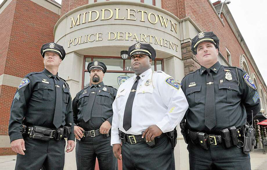 Five members of the Middletown Police Department were promoted Friday afternoon. From left, Sgt. Daniel Petrulis, Sgt. Frank Scirpo, Capt. Gary Wallace and Sgt. Dave Godwin. Not pictured is Lt. Scott Aresco. Catherine Avalone — The Middletown Press Photo: Journal Register Co. / TheMiddletownPress