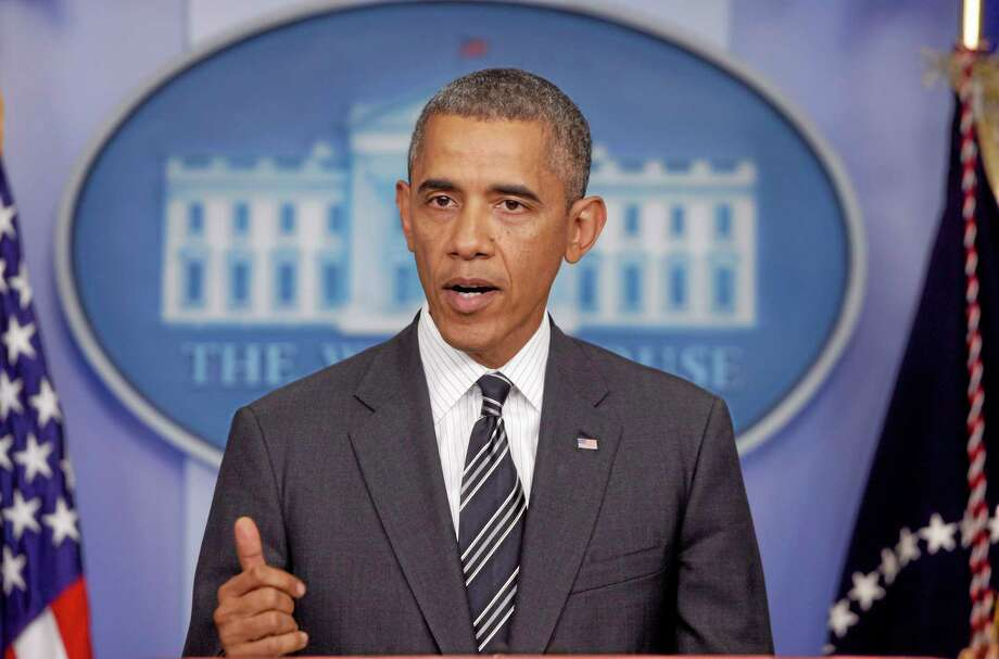 President Barack Obama makes a statement regarding the budget fight in Congress and foreign policy challenges, Friday, Sept. 27, 2013, in the James Brady Press Briefing Room of the White House in Washington.  (AP Photo/Charles Dharapak) Photo: AP / AP