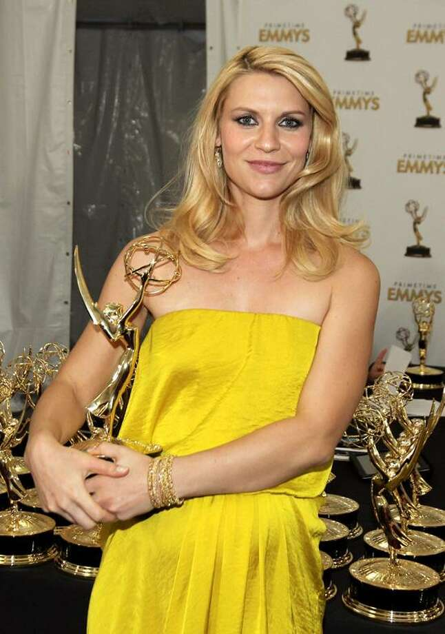 "Actress Claire Danes, winner Outstanding Lead Actress In A Drama Series for ""Homeland"", poses backstage at the 64th Primetime Emmy Awards at the Nokia Theatre on Sunday, Sept. 23, 2012, in Los Angeles.  Associated Press Photo: MATT SAYLES/INVISION/AP / Invision"