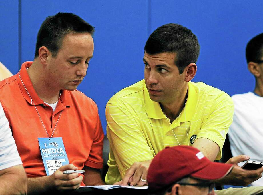Celtics director of player personnel Austin Ainge, left, talks with head coach Brad Stevens during a summer league game between Boston and the Detroit Pistons on July 8 in Orlando, Fla. Photo: John Raoux — The Associated Press  / AP2013