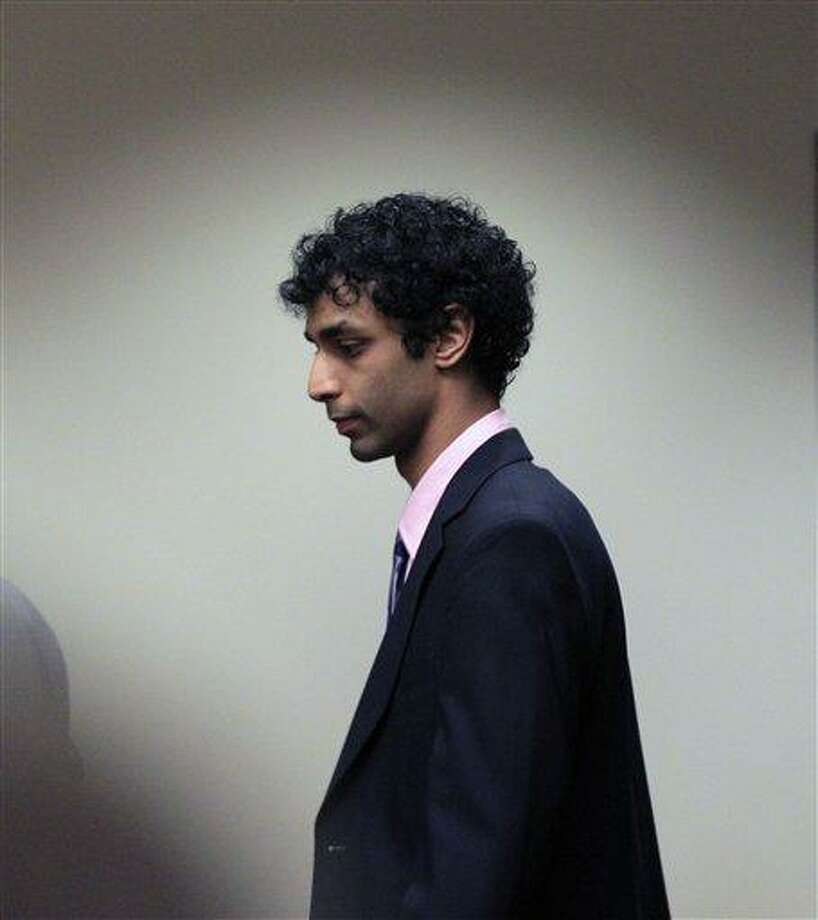 Dharun Ravi arrives at court for his sentencing hearing in New Brunswick, N.J., Monday. Ravi, a former Rutgers University student who used a webcam to watch his roommate kiss another man days before the roommate killed himself, was sentenced Monday to 30 days in jail. A judge also gave 20-year-old Dharun Ravi three years of probation. Associated Press Photo: AP / AP