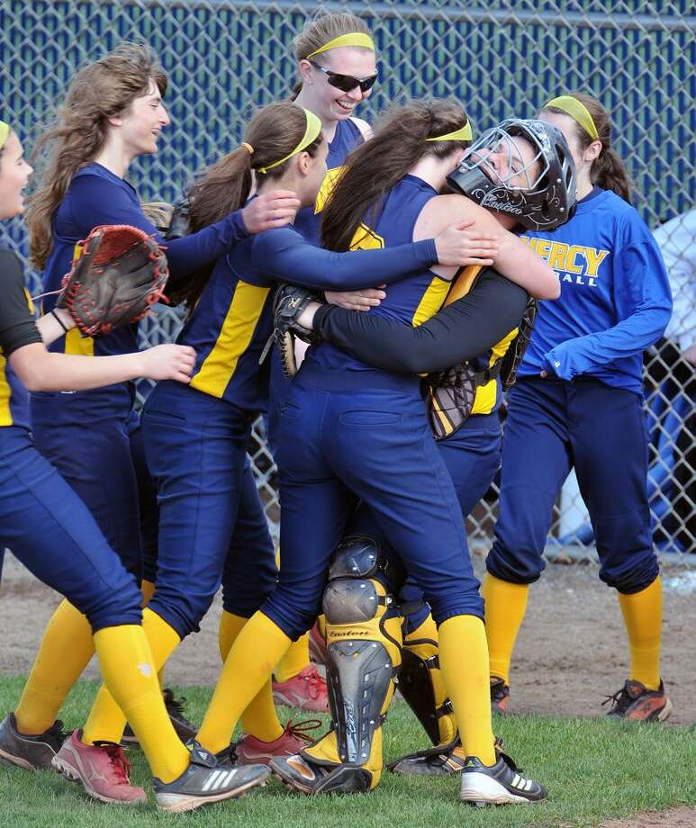 """West Haven--Mercy celebrates after beating Foran for the SCC softball title.  Photo-Peter Casolino/Register <a href=""""mailto:pcasolino@newhavenregister.com"""">pcasolino@newhavenregister.com</a>"""