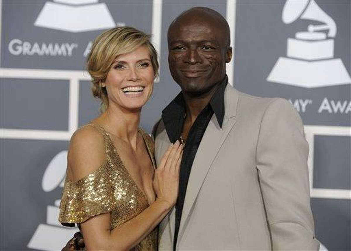 In this Feb. 13, 2011 file photo, Heidi Klum, left, and Seal arrive at the 53rd annual Grammy Awards in Los Angeles. In a statement Sunday, the power-couple announced their separation. They say after