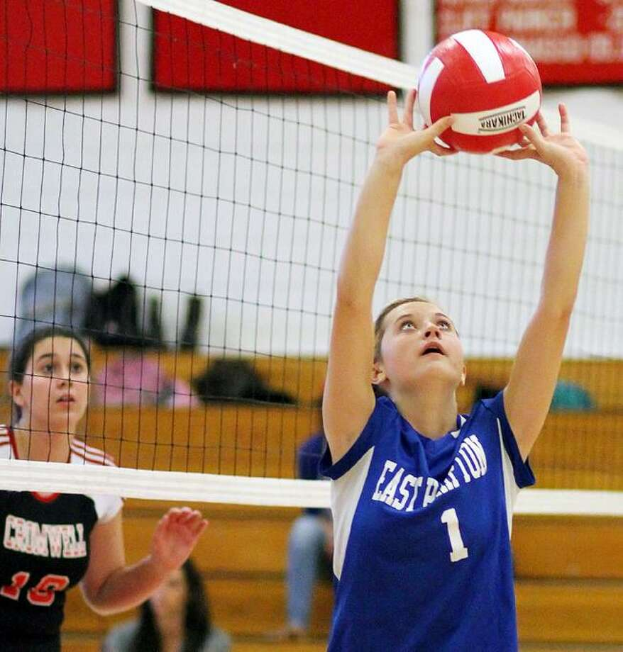 """Special to the Press  09.21.12 East Hampton's Megan Kimball watches Lauren Randall slam a spike in Friday's volleyball game against Cromwell. East Hampton won, <a href=""""http://3-0.To"""">3-0.To</a> buy a glossy print of this photo and more, visit www.middletownpress.com / a"""