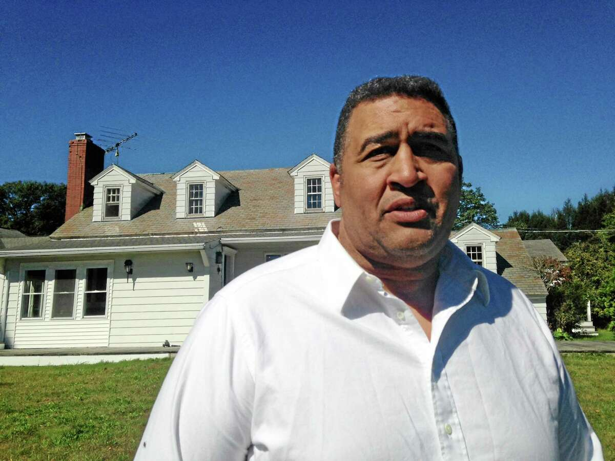 Former NFL offensive lineman Brian Holloway stands in front of his rural vacation home on Sept. 18 in Stephentown, N.Y. Holloway's home was trashed during a Labor Day weekend party attended by an estimated 200 to 400 teenagers. Holloway said the partiers caused at least $20,000 in damage, breaking windows and doors, punching holes in walls and spraying graffiti.