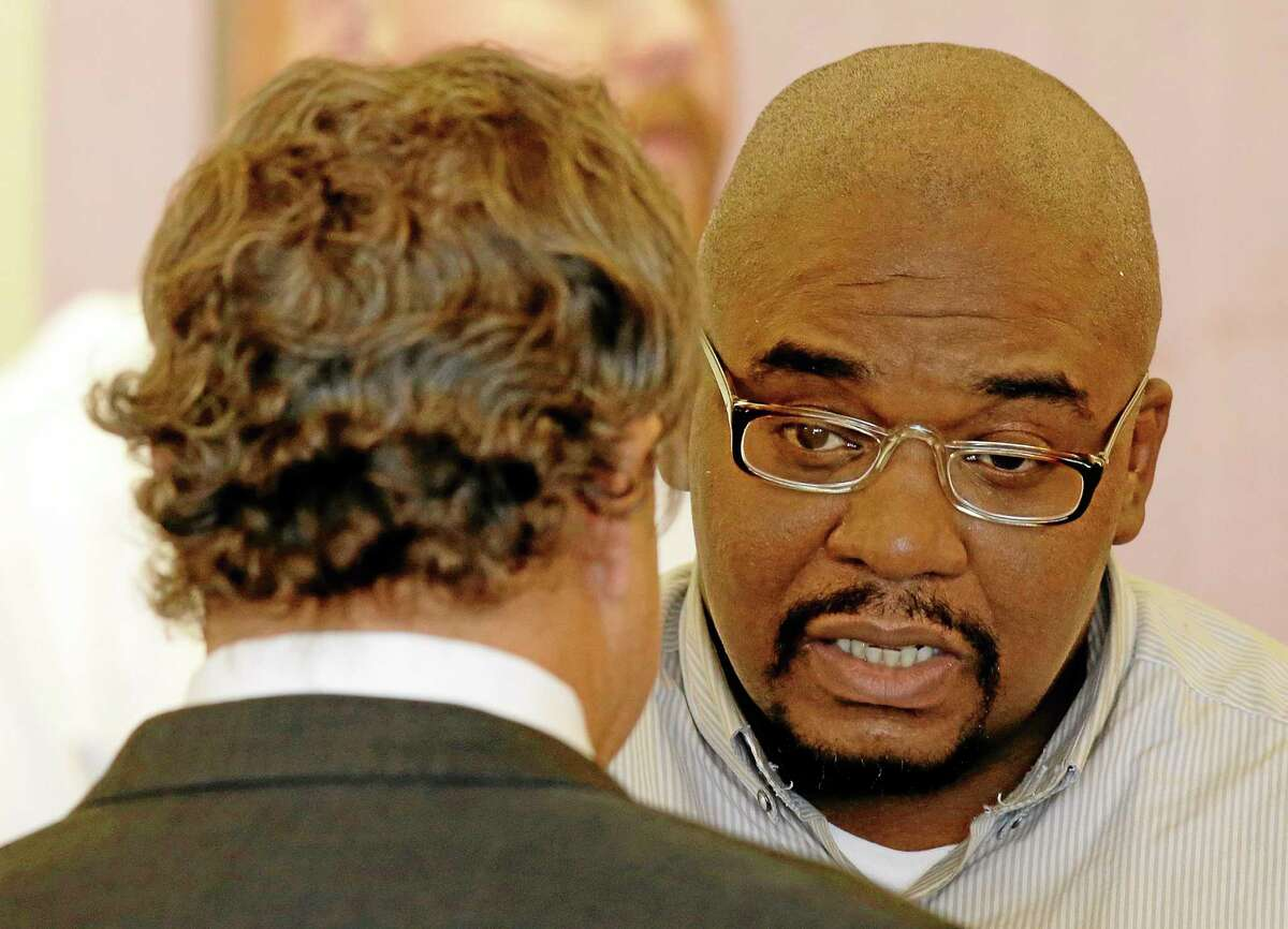 Ernest Wallace, right, an associate of former New England Patriots tight end Aaron Hernandez, talks with his attorney David Meier during an appearance Thursday in Bristol Superior Court for a bail hearing on a charge of accessory to murder after the fact in the death of semi-professional football player Odin Lloyd in Fall River, Mass. A cash bail of $500,000 was set for Wallace.