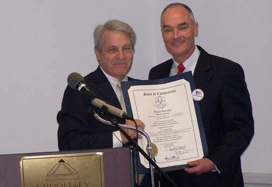 State Sen. Len Suzio presents Gary Vallo with a citation from the General Assembly.