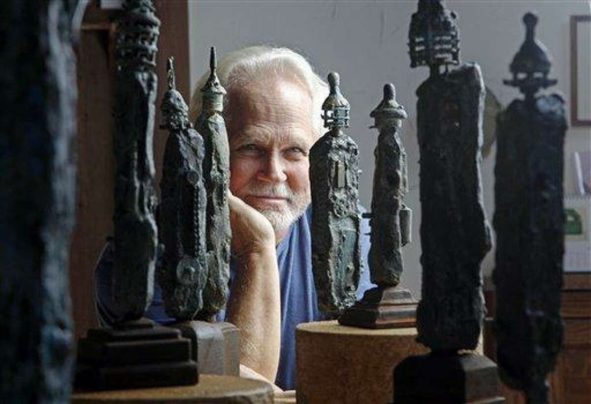 In this Thursday, Sept. 18, 2012 photo, Tony Dow, actor, director and artist, poses with some of his works at his home and studio in the Topanga area of Los Angeles. When it comes time to sitting down in a studio and carving out bronze and wooden sculptures inspired by the nature all around him, Wally isn't leaving it up to the Beav these days. Dow, who famously played the Beaver's older brother Wally on the classic 1950s-60s sitcom