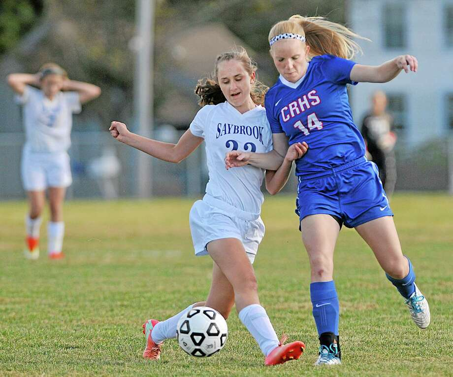 Coginchaug's Morgan Kuehnle battles Old Saybrook's Anna Chupek Thursday afternoon in the Shoreline Conference game. The Blue Devils won 2-1 on the road. Photo: Catherine Avalone — The Middletown Press  / TheMiddletownPress