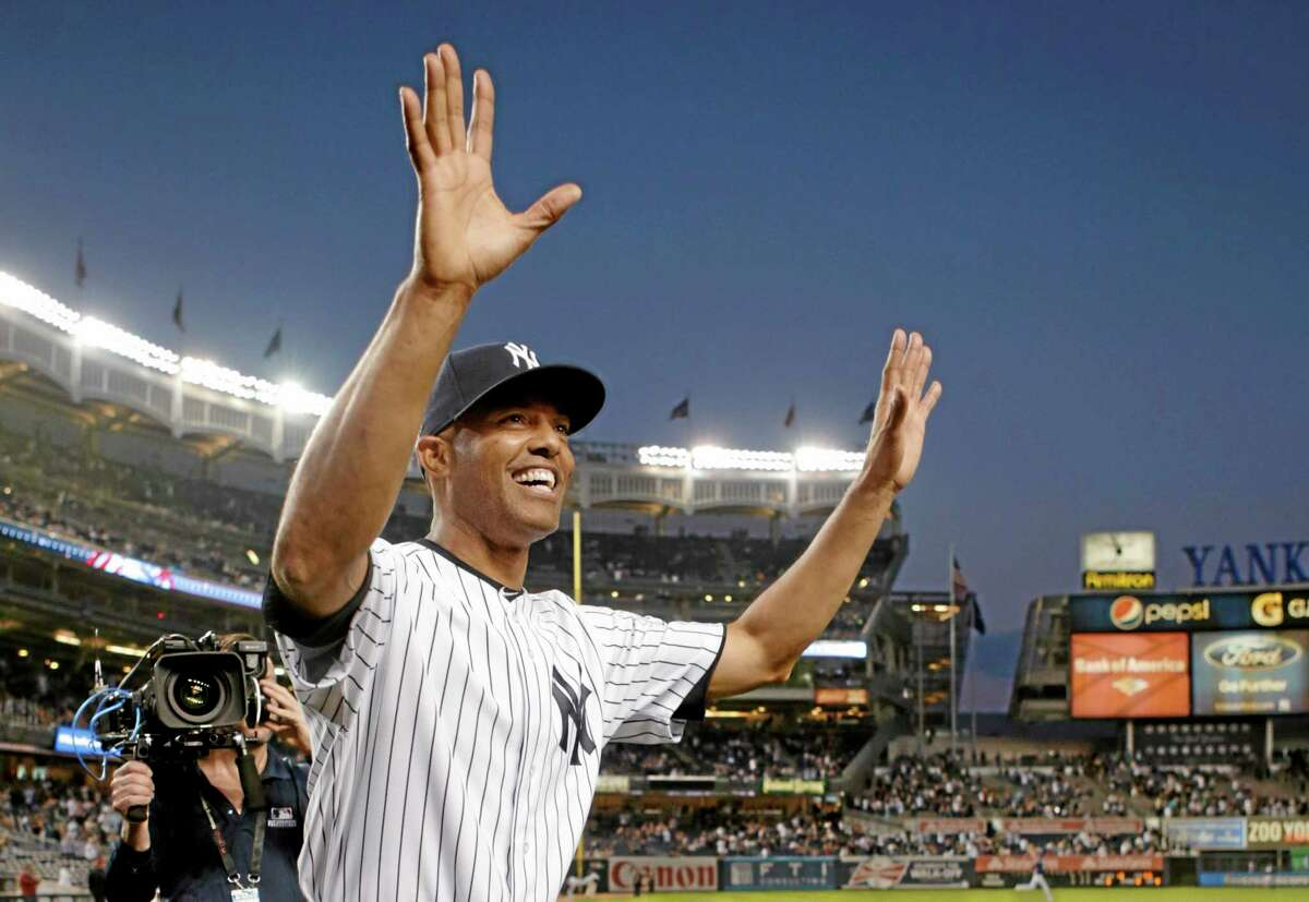 Yankees relief pitcher Mariano Rivera acknowledges fans after receiving gifts prior to his final appearance at Yankee Stadium on Thursday.