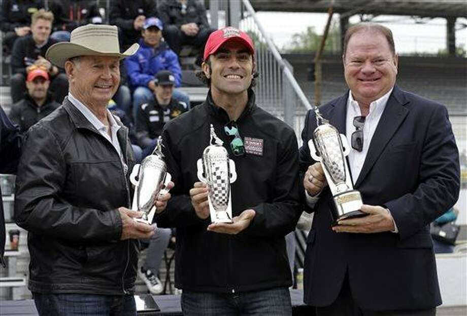 "The 2012 Indy 500 champion Dario Franchitti, of Scotland, center, along with car owner Chip Ganassi, right, and 1963 champion Parnelli Jones receive ""Baby"" Borg-Warner trophies during the public drivers meeting for the Indianapolis 500 auto race at the Indianapolis Motor Speedway in Indianapolis, Saturday, May 25, 2013. (AP Photo/Darron Cummings) Photo: AP / AP"