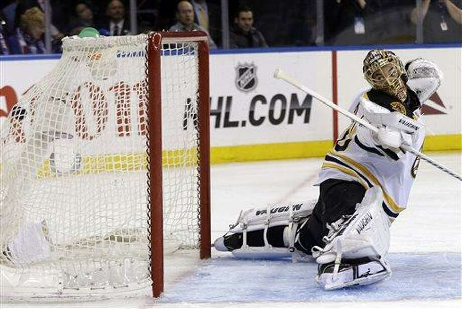 Boston Bruins goalie Tuukka Rask watches as the winning goal by New York Rangers' Chris Kreider gets past him during the overtime period in Game 4 of the Eastern Conference semifinals in the NHL hockey Stanley Cup playoffs in New York, Thursday, May 23, 2013, in New York.The Rangers defeated the Bruins 4-3. (AP Photo/Seth Wenig) Photo: AP / AP