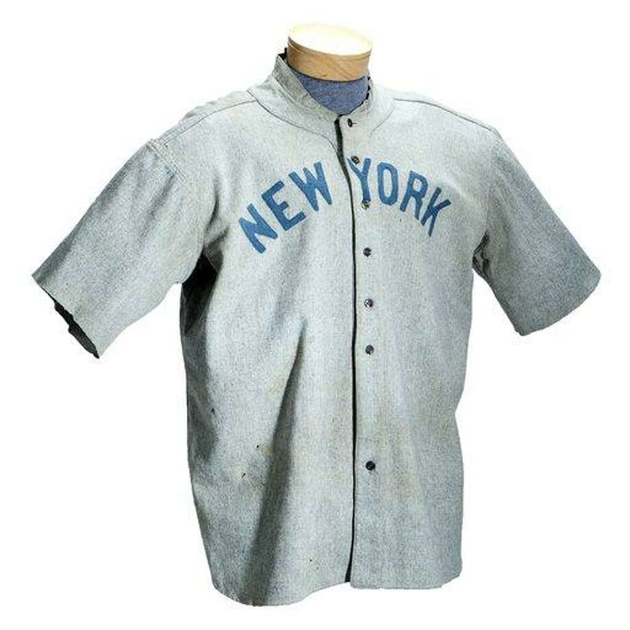 This undated photo provided by SCP Auctions shows a circa 1920 New York Yankees baseball jersey worn by Babe Ruth that sold for more than $4.4 million at auction, Sunday, May 20, 2012. SCP Auctions says the uniform top is the earliest known jersey worn by Ruth and set a record for any item of sports memorabilia. (AP Photo/SCP Auctions) Photo: AP / ©LeslieBIrd