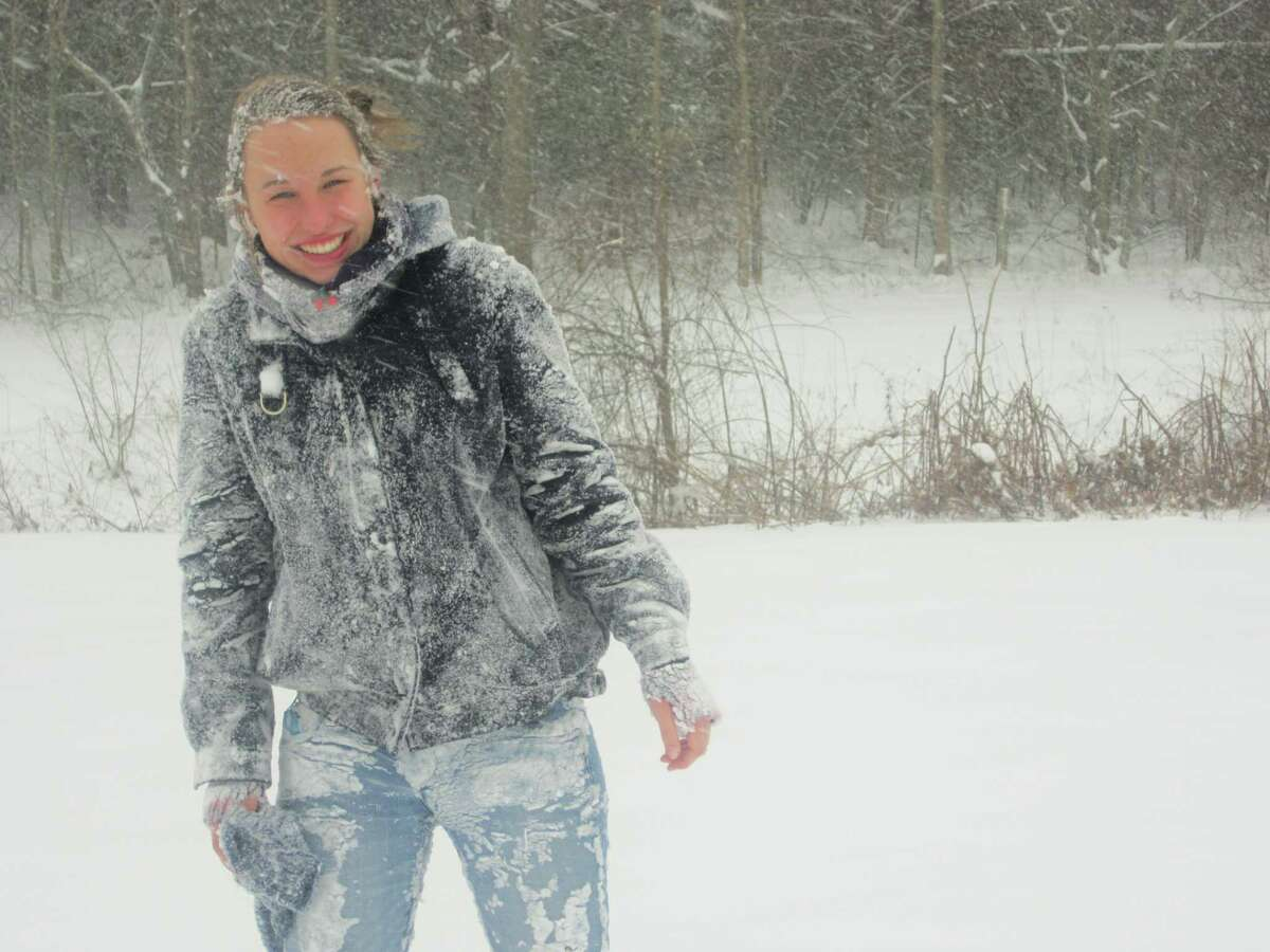 Pia Sickert, an exchange student from Hamburg, Germany, attending Vinal Tech High School in Middletown, is enjoying her first real snowfall in Middletown on Saturday