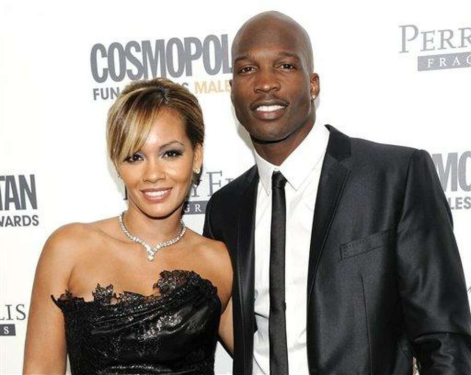 FILE - This March 7, 2011 file photo shows NFL Football player and reality television star Chad Johnson and Evelyn Lozada attending Cosmopolitan Magazine's Fun Fearless Males of 2011 event in New York. Six-time Pro Bowl wide receiver Chad Johnson's divorce is final from reality TV star Evelyn Lozada, a month after his arrest on a domestic battery charge. Johnson's attorney, Adam Swickle, confirmed on Wednesday that the couple who wed on July 4 are now divorced. (AP Photo/Evan Agostini, file) Photo: AP / AGOEV