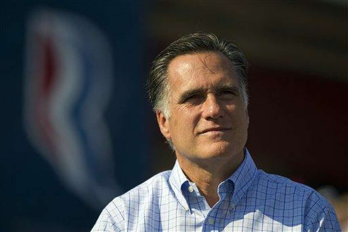 Republican presidential candidate, former Massachusetts Gov. Mitt Romney listens as vice presidential running mate Rep. Paul Ryan, R-Wis., not pictured, speaks during a campaign rally on Saturday, Aug. 25, 2012 in Powell, Ohio. (AP Photo/Evan Vucci)