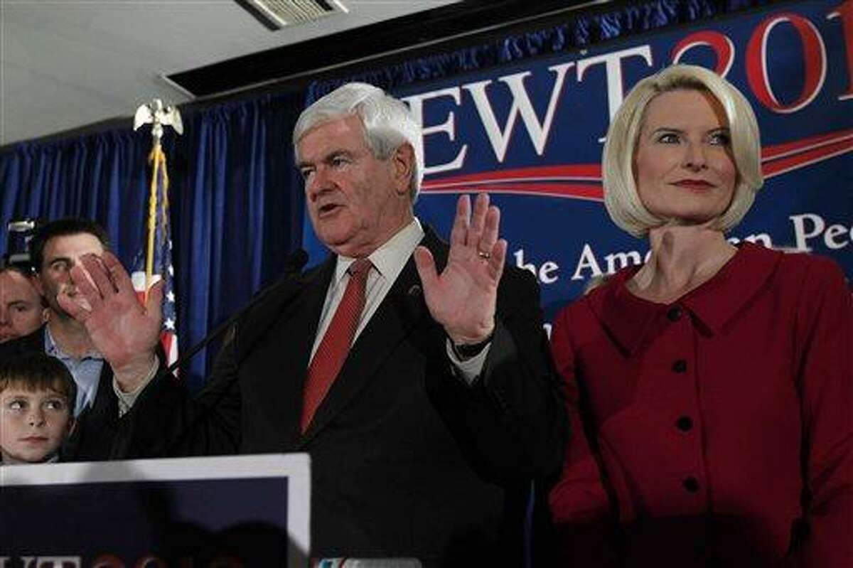Republican presidential candidate and former House Speaker Newt Gingrich speaks as his wife Callista, right, looks on during a South Carolina Republican presidential primary night rally Saturday in Columbia, S.C. Newt Gingrich won the South Carolina primary. Associated Press