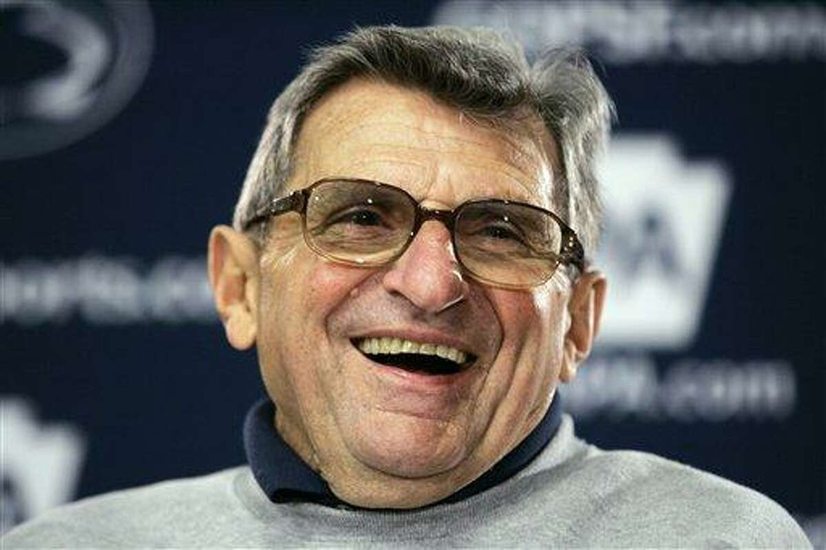 In this March 29, 2008 file photo, Penn State coach Joe Paterno laughs during a news conference after coaching an NCAA college football practice in State College, Pa. On Sunday, family says Paterno, winningest coach in major college football, has died. Associated Press