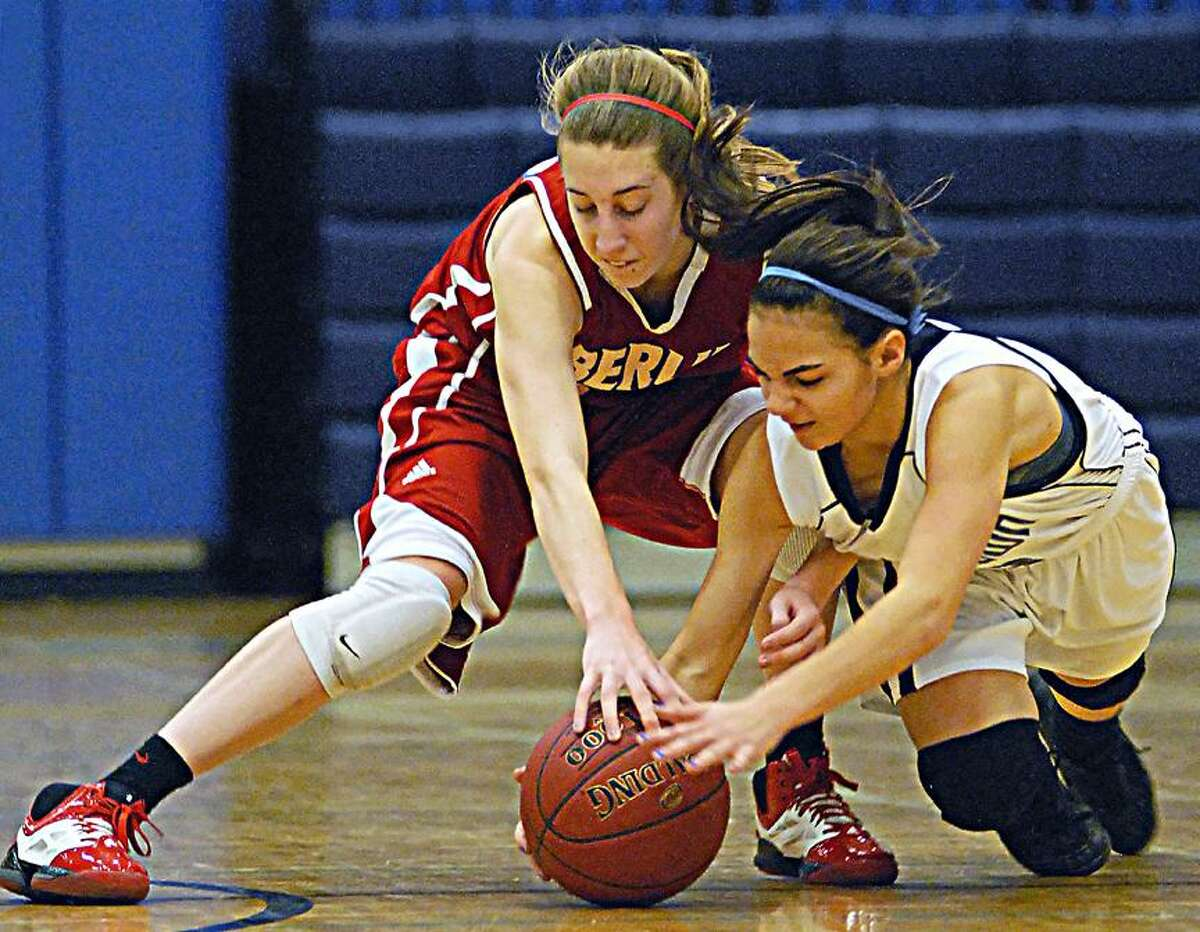 Catherine Avalone/The Middletown PressMiddletown junior Marissa Aldieri battles Berlin's Paige Young for a loose ball during Thursday night's game at the Labella-Sullivan Gymnasium in Middletown. The Redcoats defeated the Blue Dragons 57-51.