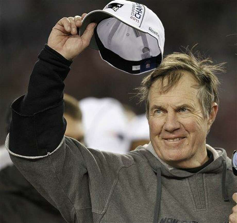 New England Patriots head coach Bill Belichick tips his hat to the crowd during the trophy presentation after the AFC Championship NFL football game  Sunday, Jan. 22, 2012, in Foxborough, Mass. The Patriots defeated the Ravens 23-20 to win the AFC Championship. (AP Photo/Winslow Townson) Photo: AP / FR170221 AP