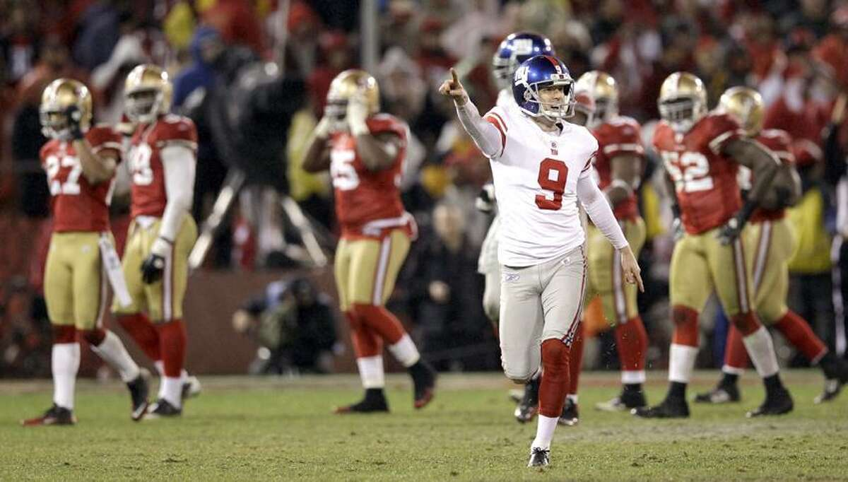 New York Giants' Lawrence Tynes reacts after kicking the game-winning field goal during overtime of the NFC Championship NFL football game against the San Francisco 49ers Sunday, Jan. 22, 2012, in San Francisco. The Giants won 20-17 to advance to Super Bowl XLVI. (AP Photo/David J. Phillip)