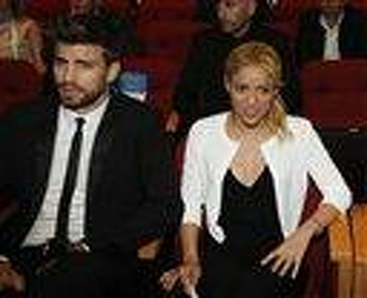 Shakira with her boyfriend, FC Barcelona Gerard Pique, left, during a plenary session at the President's Conference in Jerusalem. Shakira promoted her global education campaign with a stop at a joint Israeli-Arab school in Jerusalem.
