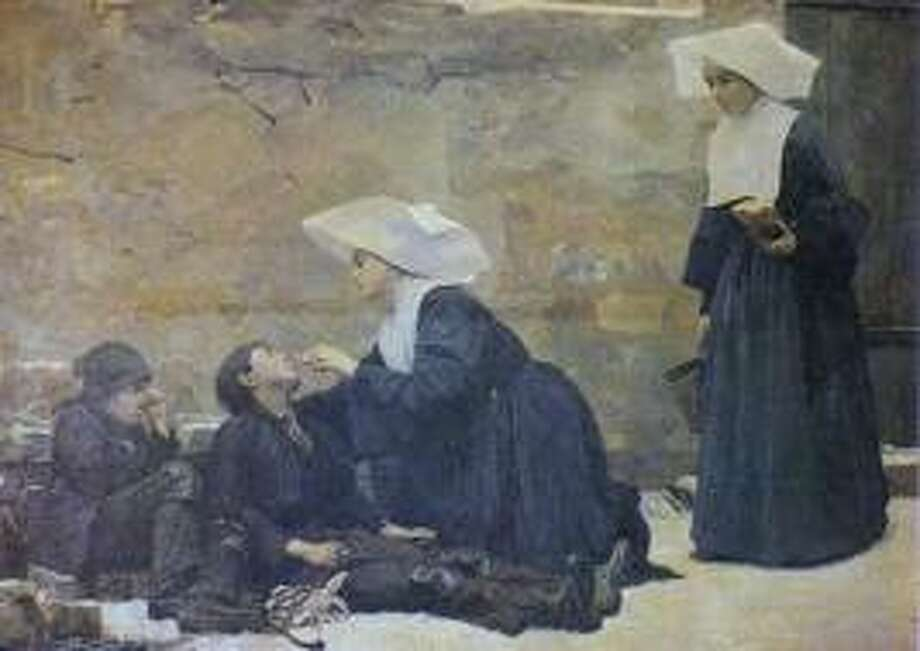 A painting shows Daughters of Charity in their traditional coronets, doing their usual work with the poor.