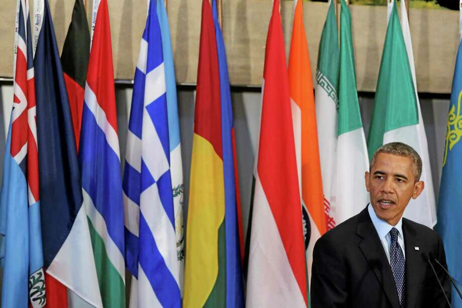 U.S. President Barack Obama speaks during a luncheon hosted by United Nations Secretary-General Ban Ki-moon in honor of Heads of State and Government,  Tuesday, Sept. 24, 2013 at United Nations headquarters.  (AP Photo/Mary Altaffer) Photo: AP / AP