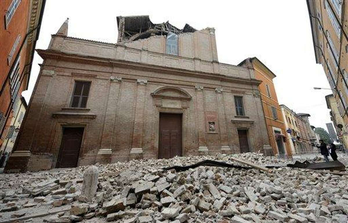 Debris of a collapsed church block a road in Finale Emilia, east of Bologna in northern Italy after the region was hit a quake early Sunday. Associated Press