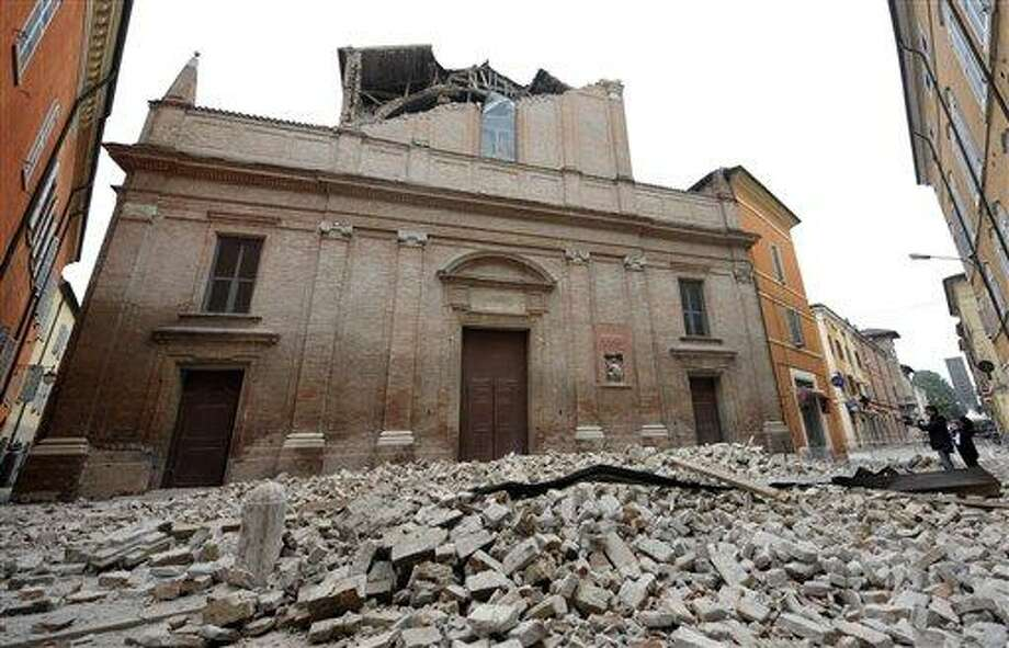 Debris of a collapsed church block a road in Finale Emilia, east of Bologna in northern Italy after the region was hit a quake early Sunday. Associated Press Photo: ASSOCIATED PRESS / AP2012