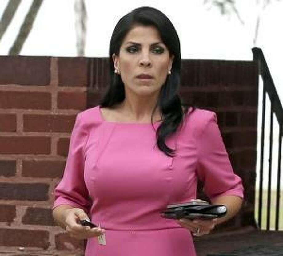 FILE - In this Nov. 13, 2012, file photo, Jill Kelley leaves her home in Tampa, Fla. South Korea will revoke an honorary title given to the American socialite tied to the scandal involving former CIA director David Petraeus, officials said Tuesday, Nov. 27, 2012. (AP Photo/Chris O'Meara, File) Photo: AP / AP