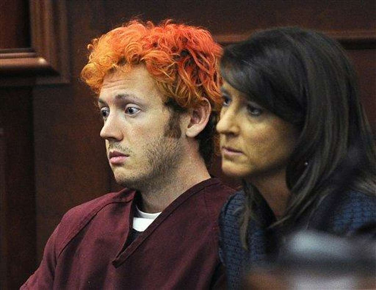 FILE - In this Monday, July 23, 2012 file photo, James Holmes, accused of killing 12 people in Friday's shooting rampage in an Aurora, Colo., movie theater, appears in Arapahoe County District Court with defense attorney Tamara Brady in Centennial, Colo. A court hearing Thursday, Aug. 30, 2012 will examine Holmes' relationship with a University of Colorado psychiatrist to whom he mailed a package containing a notebook that reportedly contains violent descriptions of an attack. His attorneys say Holmes is mentally ill and that he sought help from psychiatrist Lynne Fenton at the school, where he was a Ph.D. student, until shortly before the July 20 shooting. Prosecutors allege Holmes may have been angry at the failure of a once promising academic career. (AP Photo/Denver Post, RJ Sangosti, Pool, File)