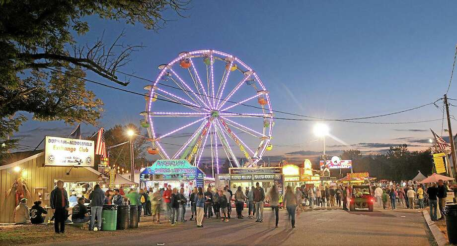 The hustle and bustle at the Durham Fair Thursday night. Catherine Avalone - The Middletown Press Photo: Journal Register Co. / TheMiddletownPress