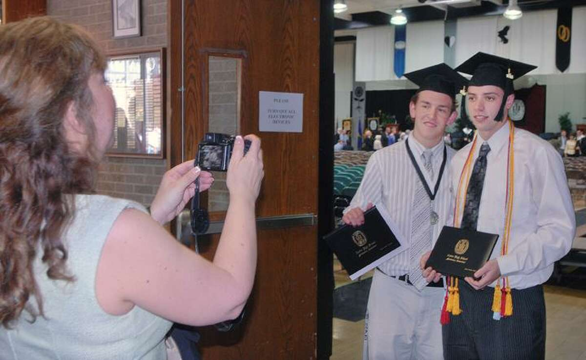 Special to the Press 5.20.12 Brett Madore, left and Michael Killen, members of Xavier High School's class of 2012 wait in the hallway shortly before processing in at commencement exercises Sunday afternoon.