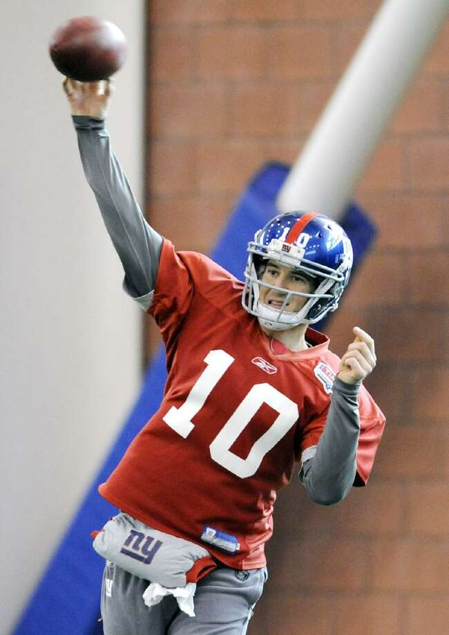 ASSOCIATED PRESS New York Giants quarterback Eli Manning throws a pass during practice Thursday in East Rutherford, N.J. The Giants travel to San Francisco to play the 49ers in the NFC championship game Sunday at 6:30 p.m.