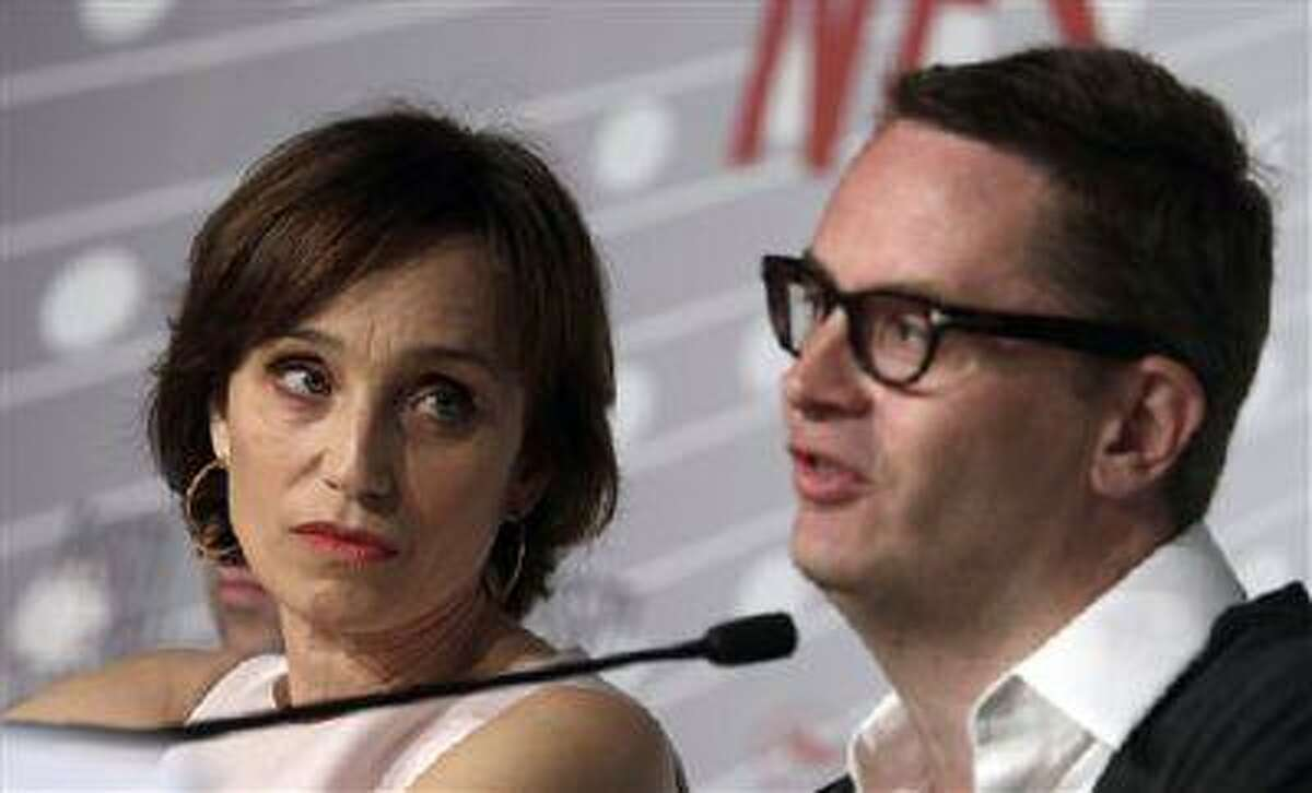 Director Nicolas Winding Refn, right, and actress Kristin Scott Thomas participate in a press conference for the film Only God Forgives at the 66th international film festival, in Cannes, southern France, Wednesday, May 22, 2013. (AP Photo/Virginia Mayo)