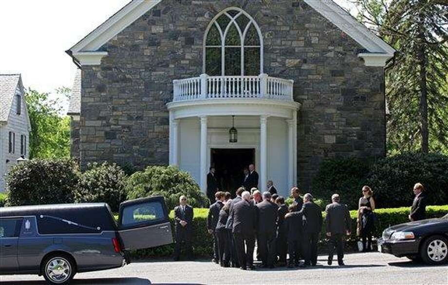Members of Mary Richardson Kennedy's family remove her casket from a hearse at St. Patrick's Church in Bedford, N.Y., Saturday. Kennedy was found dead of an apparent suicide this week at her home in Bedford.  Associated Press Photo: AP / FR61802 AP