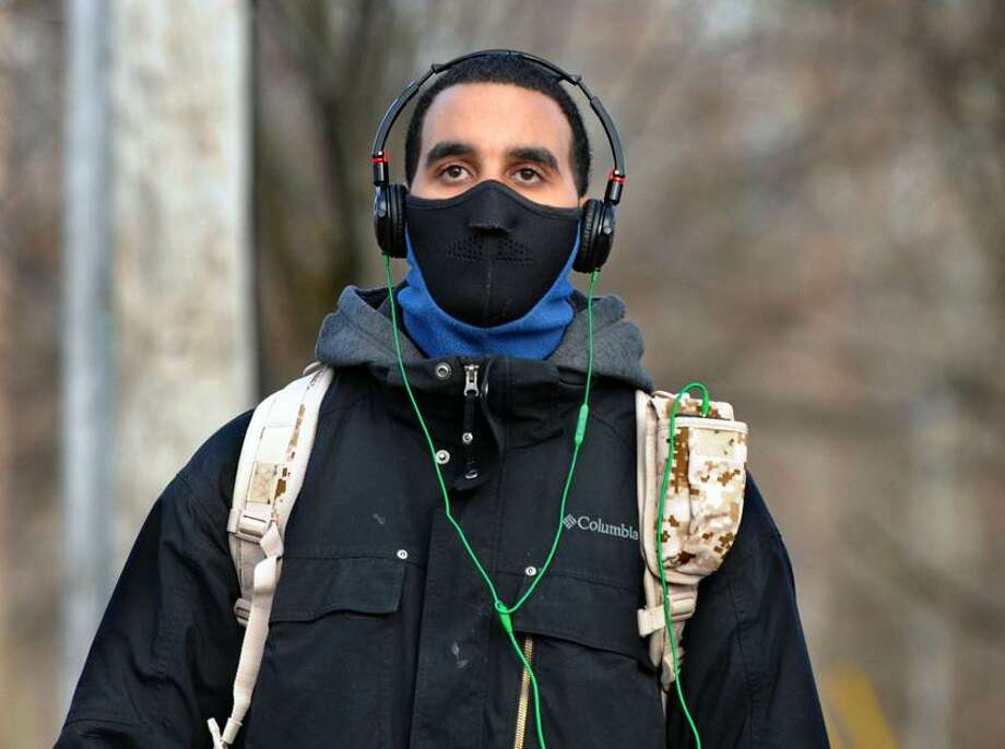William Zoni of Hamden walked about two miles in the frigid Tuesday temperatures to a friend's house in New Haven. His hat stayed in his pocket but he needed the face mask for the wind. Mara Lavitt/New Haven Register1/22/13