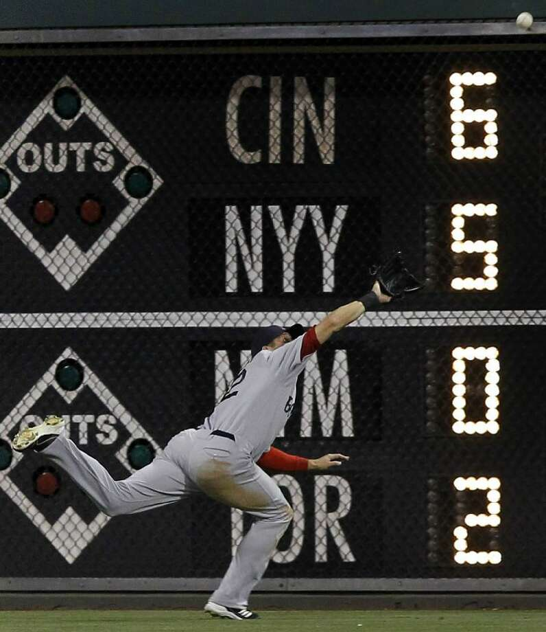 ASSOCIATED PRESS Boston Red Sox center fielder Ryan Sweeney makes a diving catch on a ball hit by Philadelphia Phillies' Carlos Ruiz during the seventh inning of Saturday's interleague game in Philadelphia. The Red Sox won 7-5.