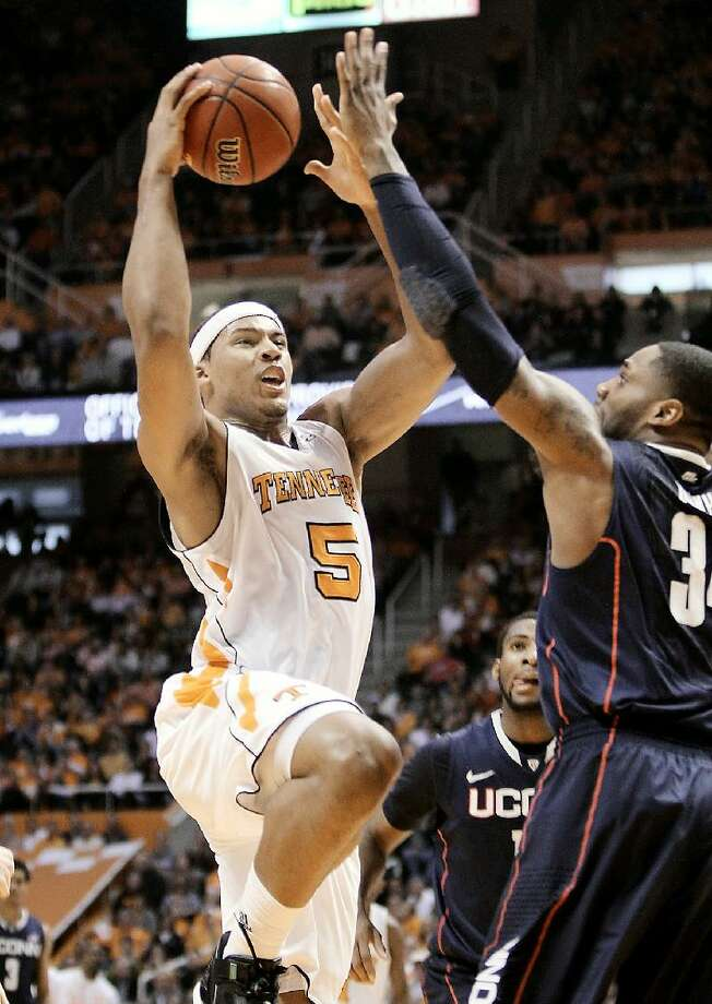ASSOCIATED PRESS Tennessee's Jarnell Stokes (5) goes for a basket against Connecticut's Alex Oriakhi at Thompson-Boling Arena in Knoxville, Tenn. on Saturday . The Tennessee Volunteers upset Connecticut 60-57.