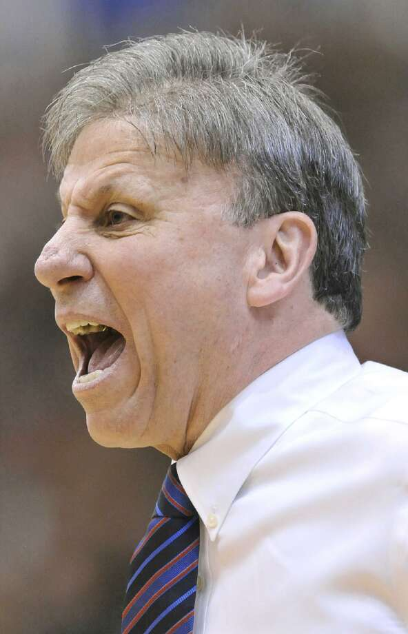 ASSOCIATED PRESS DePaul's head coach Doug Bruno yells to his players in the first half of Saturday's game against Connecticut in Chicago. Connecticut won 88-44.
