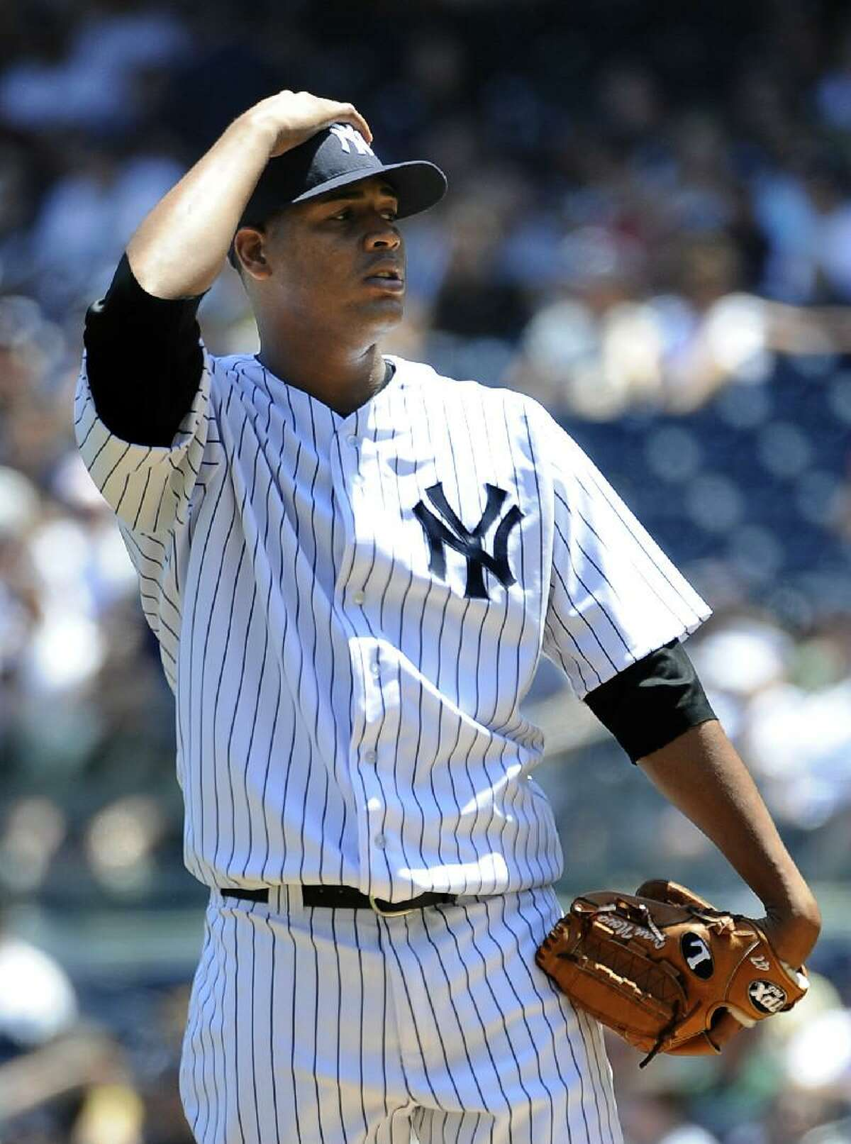 ASSOCIATED PRESS New York Yankees starting pitcher Ivan Nova reacts after he walks Cincinnati Reds' Joey Votto in the first inning of Saturday's game at Yankee Stadium in New York. The Reds won 6-5.